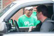 Ohio University President Roderick McDavis (Center) greets and helps new students during move- in weekend. Photo by Ben Siegel/ Ohio University