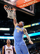 Dec. 22, 2011; Phoenix, AZ, USA; Denver Nuggets center Chris Andersen (11) dunks the ball against the Phoenix Suns during a preseason game at the US Airways Center. Mandatory Credit: Jennifer Stewart-US PRESSWIRE.