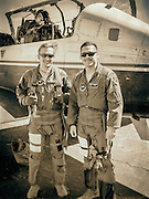 U.S. Air Force instructor pilots, photographed next to their Beechcraft T-6 Texan II turboprop trainer.  Dekalb Peachtree Airport (PDK), Atlanta.  Created by aviation photographer John Slemp of Aerographs Aviation Photography. Clients include Goodyear Aviation Tires, Phillips 66 Aviation Fuels, Smithsonian Air & Space magazine, and The Lindbergh Foundation.  Specialising in high end commercial aviation photography and the supply of aviation stock photography for commercial and marketing use.