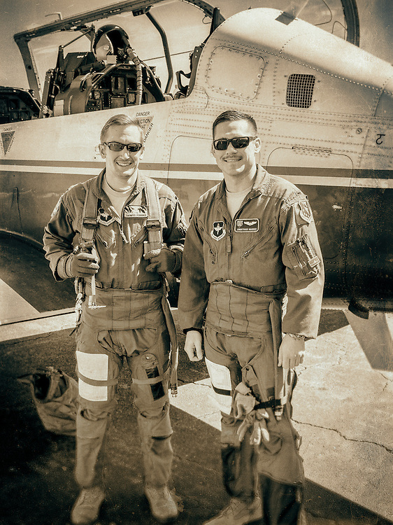 U.S. Air Force instructor pilots, photographed next to their Beechcraft T-6 Texan II turboprop trainer.  Dekalb Peachtree Airport (PDK), Atlanta.  <br /> <br /> Created by aviation photographer John Slemp of Aerographs Aviation Photography. Clients include Goodyear Aviation Tires, Phillips 66 Aviation Fuels, Smithsonian Air & Space magazine, and The Lindbergh Foundation.  Specialising in high end commercial aviation photography and the supply of aviation stock photography for advertising, corporate, and editorial use.