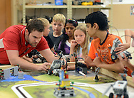 Instructor Josh Elliott (left) works helps students with a robot during the summer STEM (Science, Technology, Engineering and Mathematics) academy Friday July 31, 2015 at Neshaminy High School Middletown, Pennsylvania. (Photo by William Thomas Cain/Cain Images)