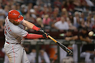 PHOENIX, AZ - JULY 08:  Tucker Barnhart #16 of the Cincinnati Reds hits a solo home run during the ninth inning of the MLB game against the Arizona Diamondbacks at Chase Field on July 8, 2017 in Phoenix, Arizona. The Cincinnati Reds won 7-0.  (Photo by Jennifer Stewart/Getty Images)