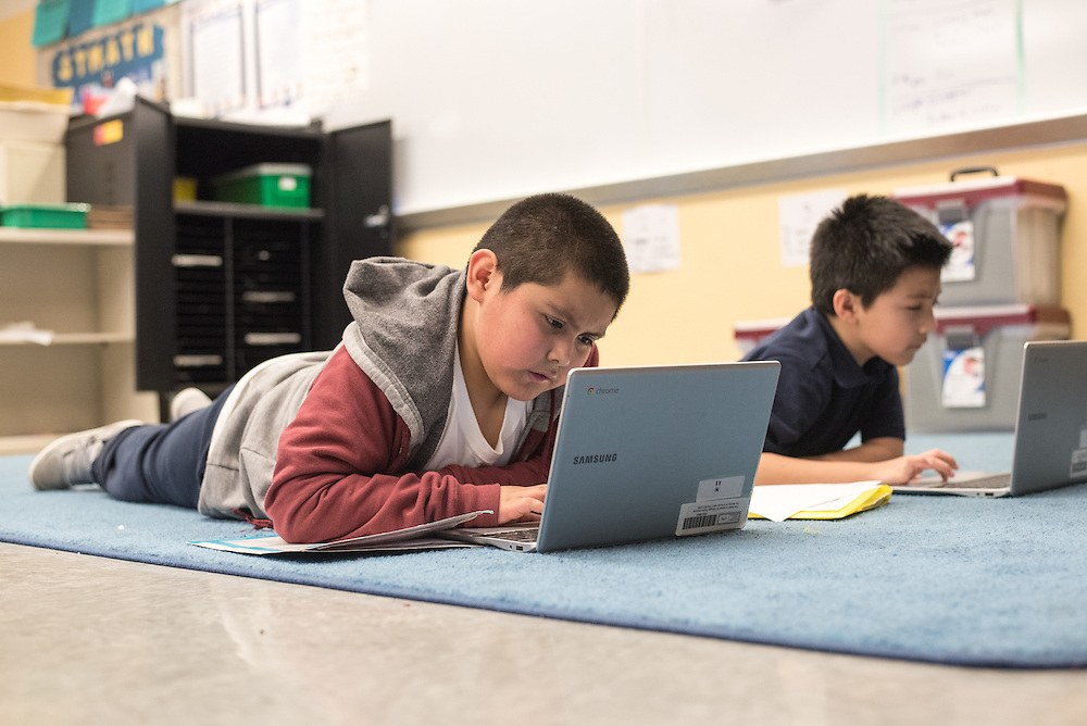 Chávez Elementary third graders use chromebooks to work on the ST Math program.