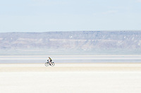 Bicycling on dry Alvord Lake, a seasonal shallow alkali lake in Harney County, Oregon