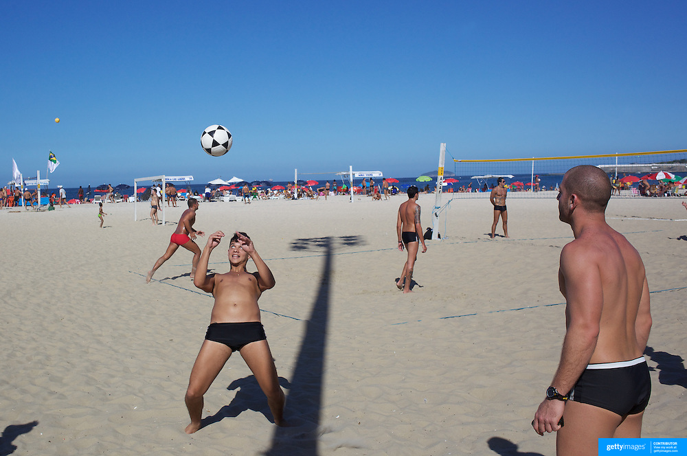 Locals practice foot  volley, a hybrid game combining beach volley ball and football at Copacabana beach, Rio de Janeiro,  Brazil. 4th July 2010. Photo Tim Clayton.