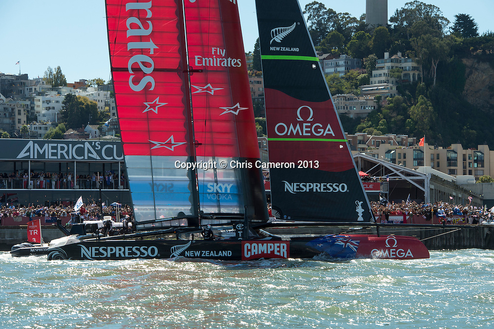 Emirates Team New Zealand pass by the America's Cup Park after losing race 14 on day 12 of America's Cup 34. 22/9/2013