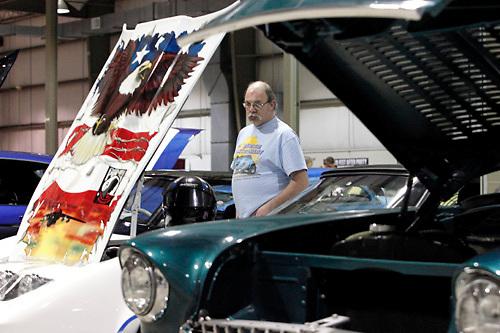 John Hurley of Sidney looks at Bull Webster of Bellbrook's 1980 custom POW Chevrolet Corvette during the KOI Hot Rod Fest Dayton at the Dayton Airport Expo Center in Vandalia, Sunday, March 12, 2012.