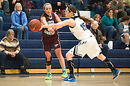 MMU's Lexi Mousley (15) blocks the pass by North Country's during the girls basketball game between the North Country Falcons and the Mount Mansfield Cougars at MMU high school on Monday night February 15, 2016 in Jericho. (BRIAN JENKINS/for the FREE PRESS)