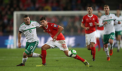 Northern Ireland's Conor Washington (left) and Switzerland's Fabian Schar battle for the ball during the FIFA World Cup Qualifying second leg match at St Jakob Park, Basel.