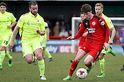 Crawley Town Striker Liam McAlinden (11)takes the ball away from Hartlepool United defender Matthew Bates (6) during the Sky Bet League 2 match between Crawley Town and Hartlepool United at the Checkatrade.com Stadium, Crawley, England on 19 March 2016. Photo by Andy Walter.