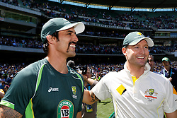 © Licensed to London News Pictures. 29/12/2013. Michael Clarke and Mitchell Johnson have a laugh after winning during Day 4 of the Ashes Boxing Day Test Match between Australia Vs England at the MCG on 29 December, 2013 in Melbourne, Australia. Photo credit : Asanka Brendon Ratnayake/LNP