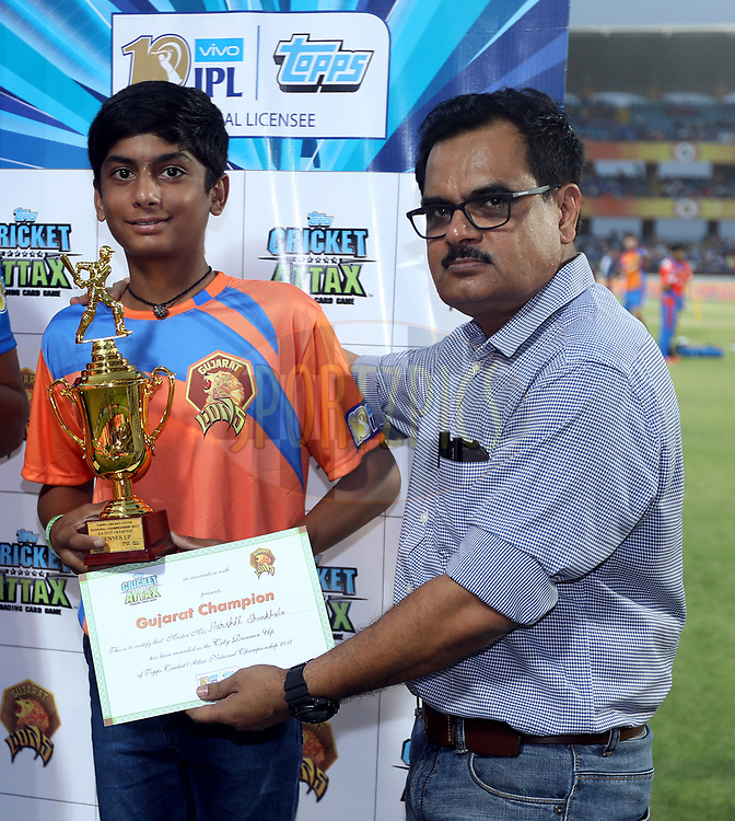 Pravin Kalnawat  Business head of Topps cricket attax gives an award to Harshil Shankhala  Runner up of Topps Cricket Attax during match 35 of the Vivo 2017 Indian Premier League between the Gujarat Lions and the Mumbai Indians  held at the Saurashtra Cricket Association Stadium in Rajkot, India on the 29th April 2017<br /> <br /> Photo by Sandeep Shetty - Sportzpics - IPL