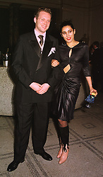 MR JOSEPH CORRE son of Vivienne Westwood and MISS SERENA REES, at a fashion show in London on 17th November 1998.MMC 99