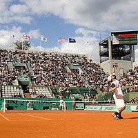 29 May 2007:  Andy Roddick of United States of America serves to Igor Andreev of Russia during the Men's Singles 1st round match, won 3-6, 6-4, 6-3, 6-4 by Igor Andreev over Andy Roddick, on day three of the French Open at Roland Garros in Paris, France.