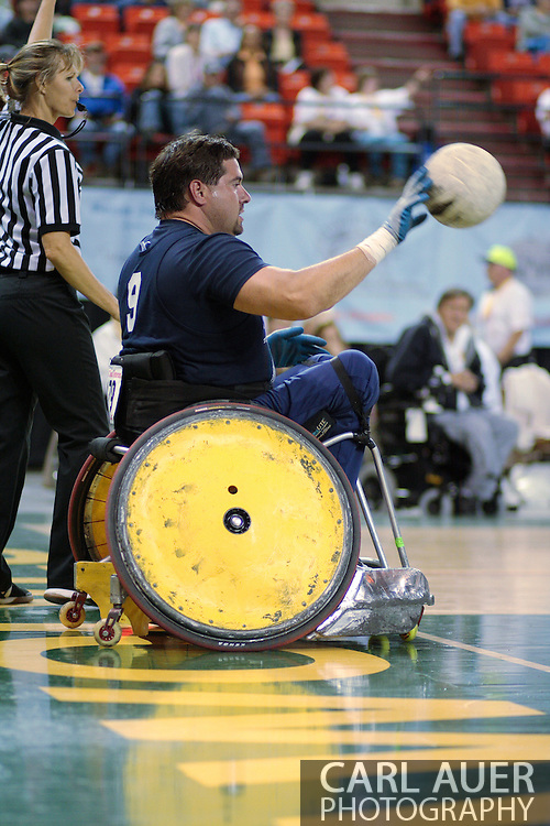 July 7th, 2006: Anchorage, AK - Scot Severn (9) inbounds the ball as White defeated Blue in the gold medal game of Quad Rugby at the 26th National Veterans Wheelchair Games.