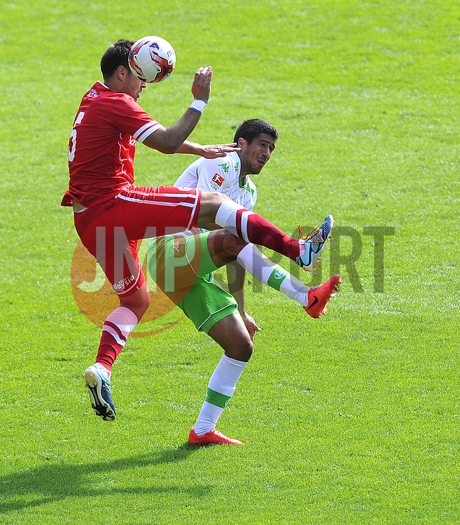 Cardiff City's Juan Cala battles for the high ball with VfL Wolfsburg's Slobodan Medojevic - Photo mandatory by-line: Joe Meredith/JMP - Mobile: 07966 386802 02/08/2014 - SPORT - FOOTBALL - Cardiff - Cardiff City Stadium - Cardiff City v VfL Wolfsburg - Pre-Season Friendly