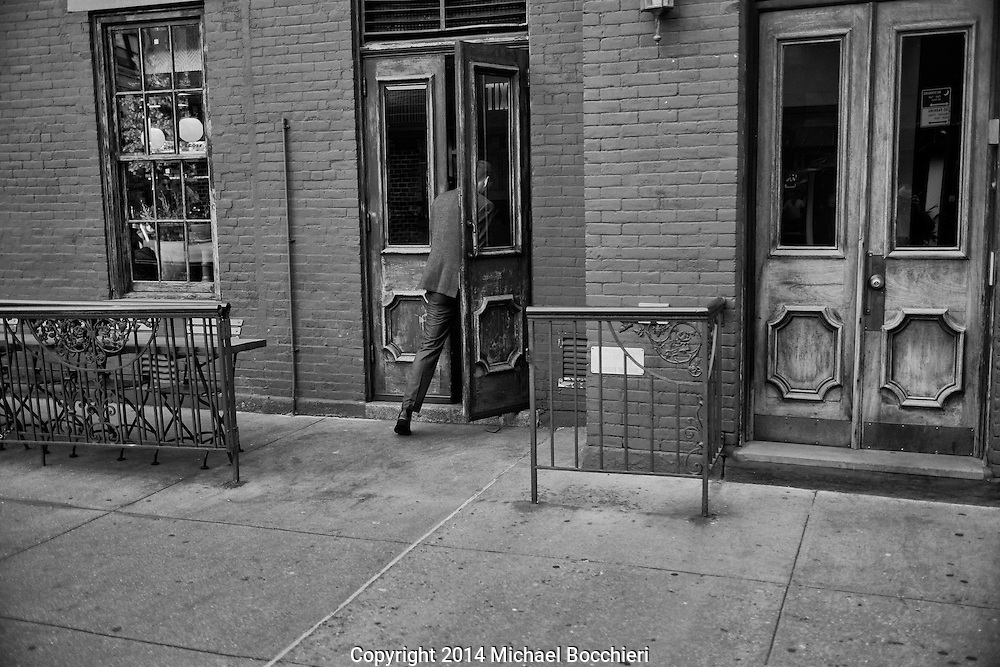 NEW YORK, NY - October 28:  A man walks in a door in SoHo on October 28, 2014 in NEW YORK, NY.  (Photo by Michael Bocchieri/Bocchieri Archive)