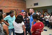 Volunteers from Keep Tucson Together and attorney Margo Cowan provide legal assistance to persons effected by changes to DACA, or Deferred Action Childhood Arrival, which provided legal protection to those brought into the United States illegally as children, at a clinic at Pueblo Magnet High School, Tucson, Arizona, USA.