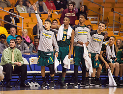 The Huntington starters celebrate a made three at the end of the game against Hurricane.