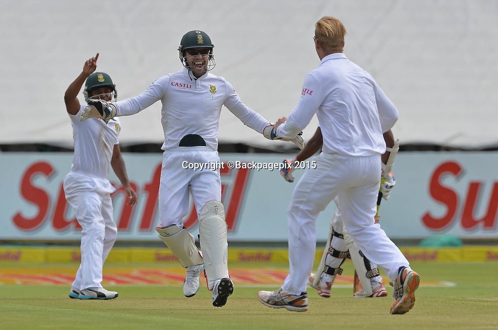 Simon Harmer of South Africa celebrates with AB de Villiers after taking the wicket of Shivnarine Chanderpaul of West Indies during Day 1 of the 2015 Sunfoil Test Series Cricket Match between South Africa and the West Indies at Newlands Stadium, Cape Town on 2 January 2015 ©Chris Ricco/BackpagePix