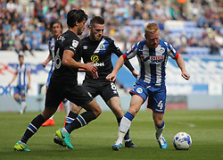 David Perkins of Wigan Athletic (R) in action against Jason Lowe (L) and Jack Byrne of Blackburn Rovers - Mandatory by-line: Jack Phillips/JMP - 13/08/2016 - FOOTBALL - DW Stadium - Wigan, England - Wigan Athletic v Blackburn Rovers - EFL Sky Bet Championship