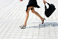detail in blur of  caucasian woman legs running on the pavment in the street