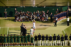 © London News Pictures. 07/07/2013 . London, UK. Andy Murray holding the trophy as he celebrates his men's singles final victory over Novak Djokovic of Serbia at the Wimbledon Lawn Tennis Championships, becoming the first British male to win the tournament in 77 years. Photo credit: Mike King/LNP
