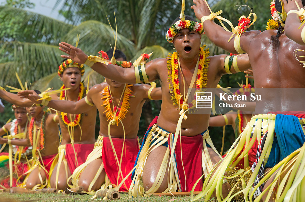 Yapase men in traditional clothing dancing at Yap Day Festival, Yap Island, Federated States of Micronesia