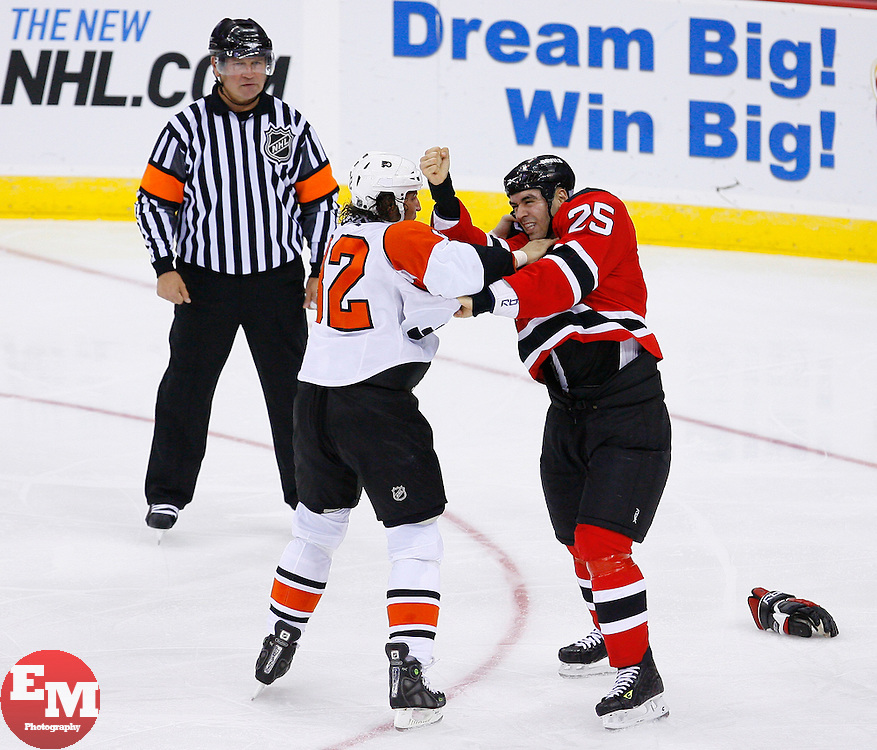 Oct 24, 2008; Newark, NJ, USA; New Jersey Devils left wing Pierre-Luc Letourneau-Leblond (25) and Philadelphia Flyers left wing Riley Cote (32) fight during the second period at the Prudential Center.