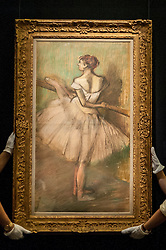 "© Licensed to London News Pictures. 19/06/2015. London, UK. Sotheby's staff show Edgar Degas' ""Danseuse à la barre"", (est. £1.0m-£1.5m) at Sotheby's Impressionist, Modern & Contemporary Art preview, ahead of the sale on 24 June 2015. Leading the sale are Kazimir Malevich's, ""Suprematism, 18th Construction"" and Edouard Manet's ""Le Bar aux Folies-Bergère"".  Photo credit : Stephen Chung/LNP"
