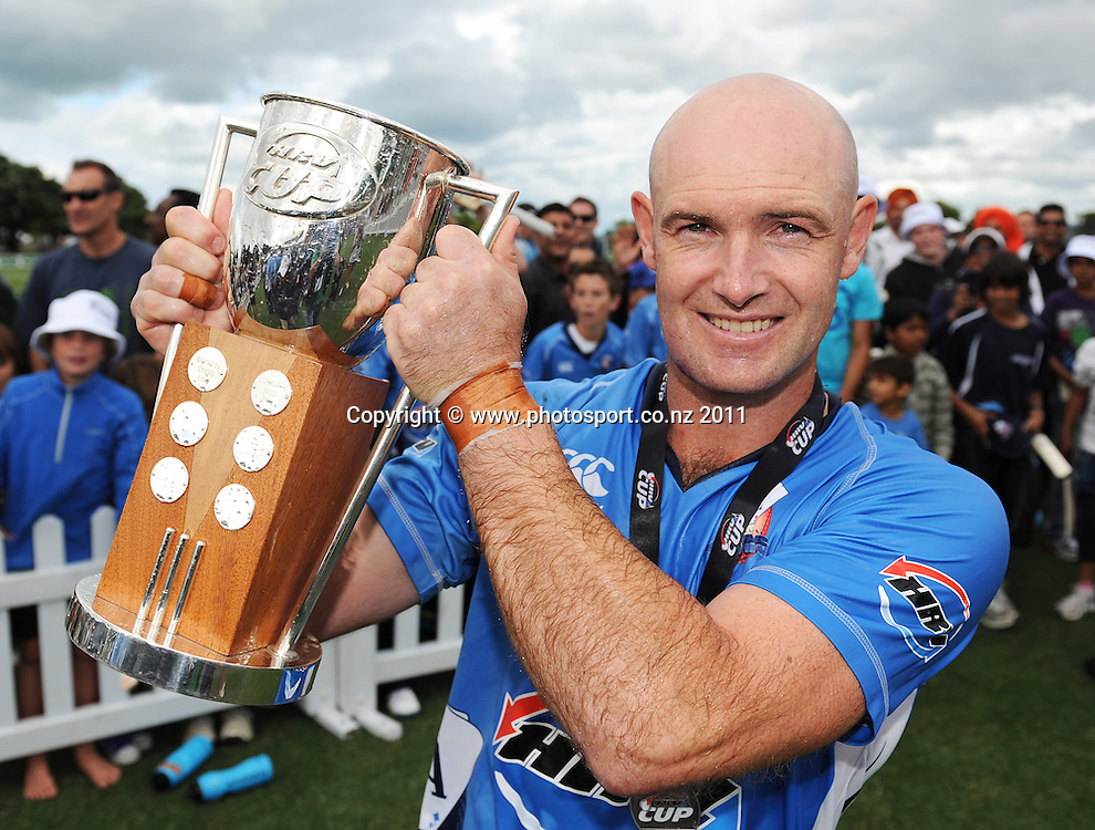 Aces captain Gareth Hopkins holds up the HRV Cup winning the HRV Twenty20 Cricket Final between the Auckland Aces and Canterbury Wizards at Colin Maiden Oval in Auckland, New Zealand on Sunday 22 January 2012. Photo: Andrew Cornaga/Photosport.co.nz