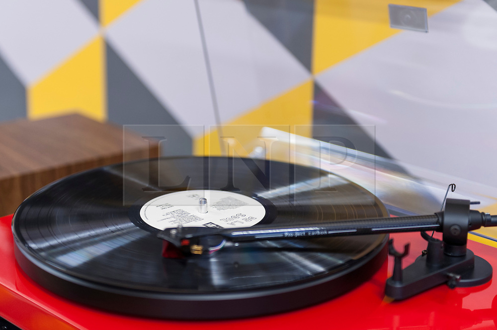 © Licensed to London News Pictures. 16/04/2016. London, UK. Turntables are available to demo LPs.  Fans of vinyl visit record shops in and around Berwick Street in Soho today, on Record Store Day, a worldwide celebration of analogue music and music to be listened to from a physical format. Photo credit : Stephen Chung/LNP