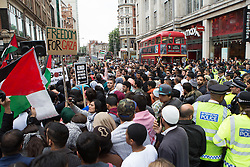 Image ©Licensed to i-Images Picture Agency. 11/07/2014. London, United Kingdom. Demonstration in London against Israeli strikes in Gaza. Central London. Hundreds of protesters get together in a demonstration against Israeli strikes in Gaza outside the Israeli Embassy in London. Picture by Daniel Leal-Olivas / i-Images