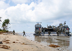 TANDUO BEACH, Malaysia (Aug. 17, 2018) Royal Malaysian marines disembark a landing craft, air cushion (LCAC) attached to Assault Craft Unit (ACU) 5 during a simulated beach assault while conducting Cooperation Afloat Readiness and Training (CARAT) 2018. CARAT Malaysia, in its 24th iteration, is designed to enhance information sharing and coordination, build mutual warfighting capability and support long-term regional cooperation enabling both partner armed forces to operate effectively together as a unified maritime force. (U.S. Navy photo by Mass Communication Specialist 3rd Class Molly DiServio/Released)180817-N-NI420-0071