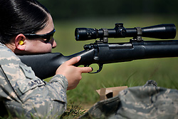 Senior Airman Jennifer Gamez, 19th Security Forces Squadron installation entry controller, prepares to fire an M24 sniper weapon system at a range on Camp Robinson, Ark., June 6, 2018. Gamez was the first female in approximately five years to complete advanced designated marksman training. (U.S. Air Force photo by Airman 1st Class Kristine M. Gruwell)