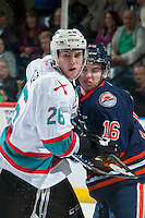 KELOWNA, CANADA - MARCH 11: Cole Linaker #26 of Kelowna Rockets checks Nick Chyzowski #16 of Kamloops Blazers on March 11, 2016 at Prospera Place in Kelowna, British Columbia, Canada.  (Photo by Marissa Baecker/Shoot the Breeze)  *** Local Caption *** Cole Linaker; Nick Chyzowski;