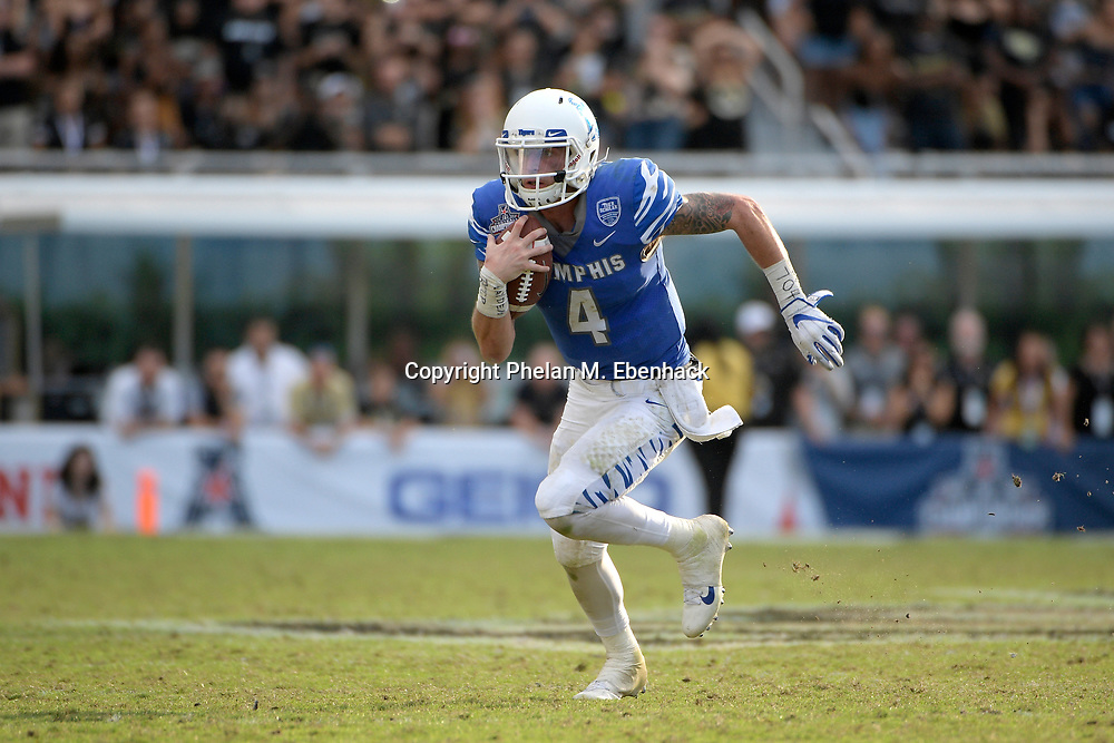 Memphis quarterback Riley Ferguson (4) scrambles for yardage during the second half of the American Athletic Conference championship NCAA college football game against Central Florida Saturday, Dec. 2, 2017, in Orlando, Fla. Central Florida won 62-55. (Photo by Phelan M. Ebenhack)