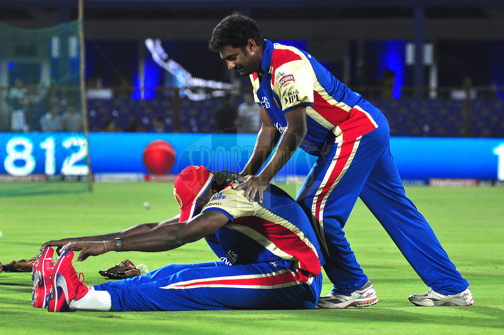 RCB player Chris Gayle with Muttiah Muralitharan during match 30 of the the Indian Premier League ( IPL) 2012  between The Rajasthan Royals and the Royal Challengers Bangalore held at the Sawai Mansingh Stadium in Jaipur on the 23rd April 2012..Photo by Arjun Panwar/IPL/SPORTZPICS