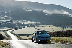 © Licensed to London News Pictures. 18/02/2016. Builth Wells, Powys, Wales, UK. A motorist drives through a frosty landscape near the small Welsh market town of Builth Wells, in Powys, Wales, UK after a night with temperatures dropping to - 2 degrees centigrade. Photo credit: Graham M. Lawrence/LNP