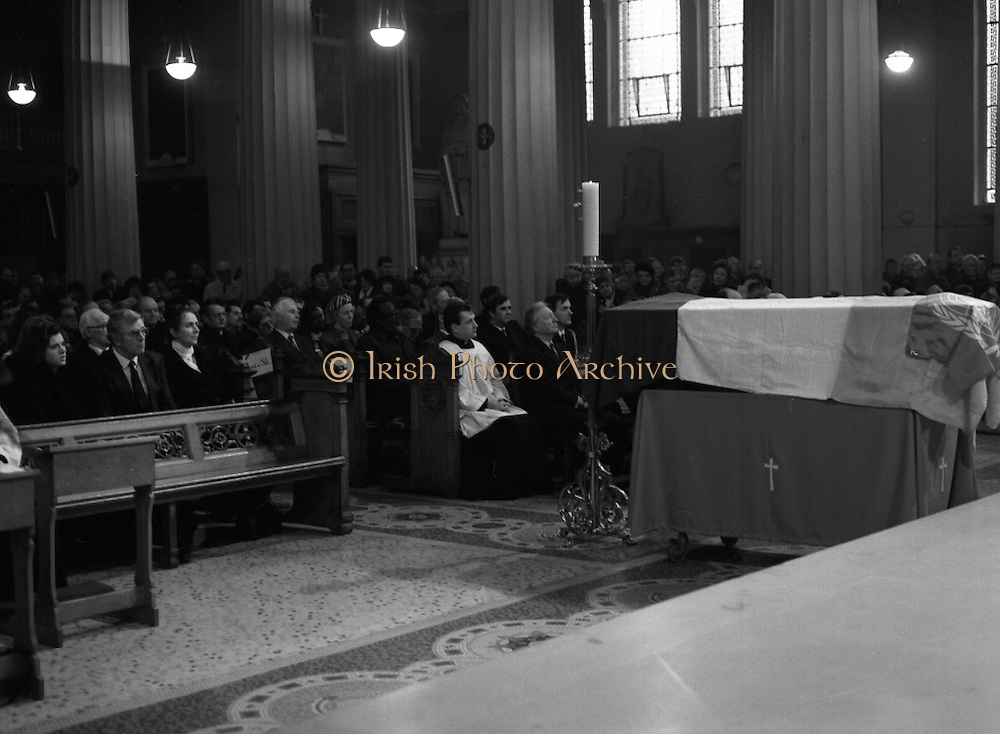 Funeral Of Sean McBride.   (R71)..1988..18.01.1988..01.18.1988..18th January 1988..Today saw the Funeral of Seán McBride.Seán MacBride was an Irish government minister, a prominent international politician and a former Chief of Staff of the IRA. His funeral took place from the Pro-Cathedral in Dublin to the family plot in Glasnevin Cemetery, Dublin.The Chief mourners were Tiernan McBride,son, Anna White,daughter and Declan White, son in law...Image shows the interior of the Pro-Cathedral with the flag draped coffin of Seán McBride in the fore front