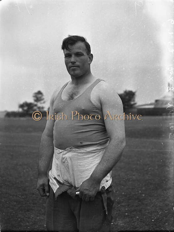 Monaghan (Armagh A.C.) winner of discus championships at Crumlin.06/07/1952