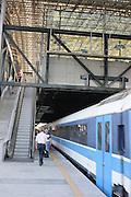 Israel, Tel Aviv, HaShalom train station passenger boards train