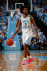 CHAPEL HILL, NC - FEBRUARY 05: Coby White #2 of the North Carolina Tar Heels dribbles the ball during a game against the North Carolina State Wolfpack on February 05, 2019 at the Dean Smith Center in Chapel Hill, North Carolina. North Carolina won 113-96. North Carolina wore retro uniforms to honor the 50th anniversary of the 1967-69 team. (Photo by Peyton Williams/UNC/Getty Images) *** Local Caption *** Coby White