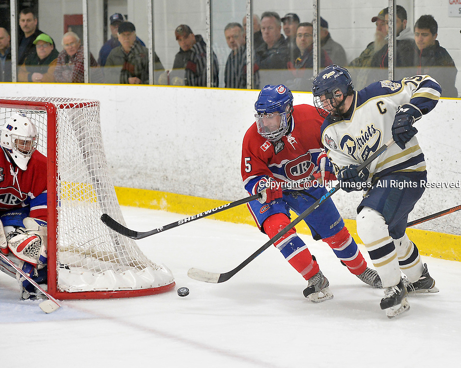 TORONTO, ON - Mar 28, 2015 : Ontario Junior Hockey League game action between the Toronto Patriots and the Toronto Jr. Canadiens. Game one of the South West Championship Series. Luke Carter #15 of the Toronto Patriots battles for the puck with Luca Farrace #5 of the Toronto Jr. Canadiens during the third period.<br /> (Photo by Shawn Muir / OJHL Images)