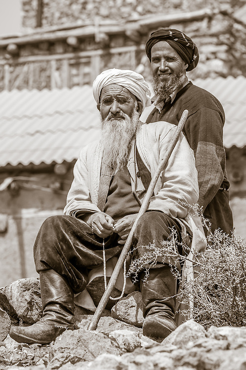 Portrait of father and son farmers in western Tajikistan