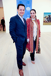 SALMAN MAHDI and his wife ANITA at the BRIC art sale preview (Brazil, Russia, India & China, the acronym BRIC here refers to the burgeoning contemporary art practices within these four countries.) organised by Phillips de Pury & Company at The Saatchi Gallery, London on 17th April 2010.