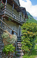 A beautiful old Ticino rustic surrounded by greenery in Valle Verzasca, Ticino, Switzerland.