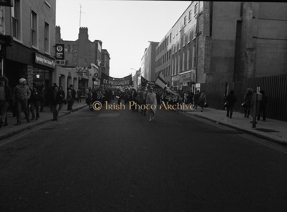 """H-Block Hunger-Strike Protest.   (M54)..1980..06.12.1980..12.06.1980..6th December 1980..In support of the prisioners on hunger strike in Northern Ireland a protest march was organised in Dublin. The march was to highlight the treatment of prisioners who wer on hunger strike and on the """"blanket"""" protest. Part of the prisioner demand was that they be treated as political prisioners and not as criminals or terrorists..The """"blanket"""" protestor is pictured leading the protest march through the streets of Dublin."""