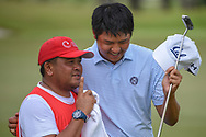 KK LIMBHASUT (THA) shares a laugh with his caddie as they depart the green on 18 following Rd 3 of the Asia-Pacific Amateur Championship, Sentosa Golf Club, Singapore. 10/6/2018.<br /> Picture: Golffile | Ken Murray<br /> <br /> <br /> All photo usage must carry mandatory copyright credit (© Golffile | Ken Murray)