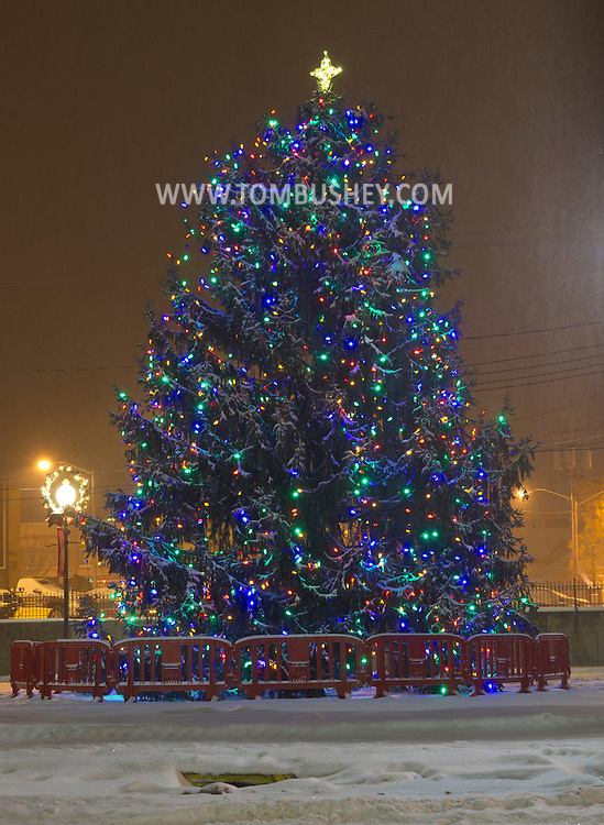 Middletown, New York - The holiday tree at Festival Square is lit during a snowstorm on Dec. 22, 2013.